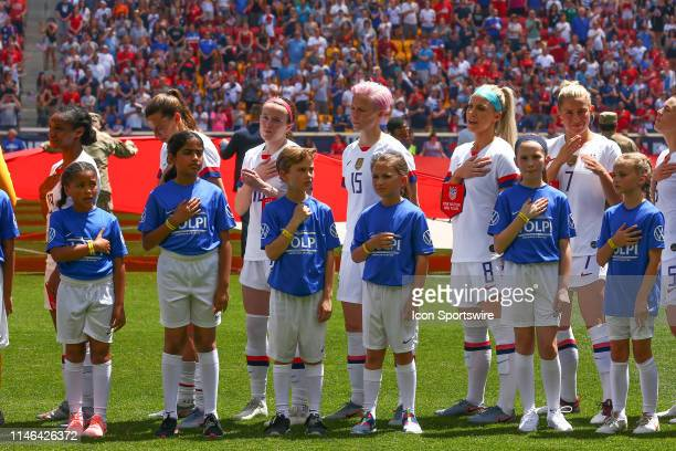 United States of America midfielder Megan Rapinoe and teammates during the National Anthem prior to the 1st half of the International Friendly match...