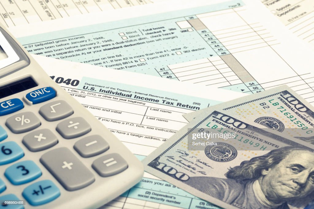 United States Of America Tax Form 1040 With Calculator And Us Dollars Filtered Image