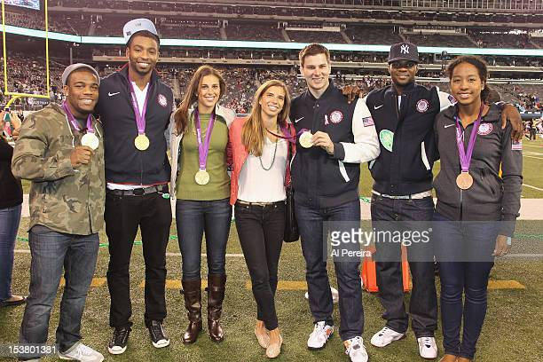 United States Olympians Jordan Burroughs Cullen Jones Carli Lloyd Tobin HeathTim Morehouse Marcus Browne and Lia Neal attends the New York Jets vs...