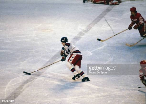 United States Olympic Hockey Team member skates the puck down the rink during the 'Miracle on Ice' against the Soviet Union on February 22 1980 at...