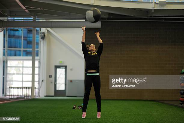 United States Olympic hopeful Adeline Gray throws a heavy ball into the air during an afternoon workout on Thursday March 31 2016 Gray who is a...