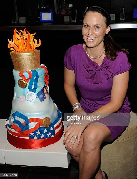 United States Olympic swimmer and model Amanda Beard appears with an Olympicthemed cake as she hosts a viewing party at Lagasse's Stadium at The...