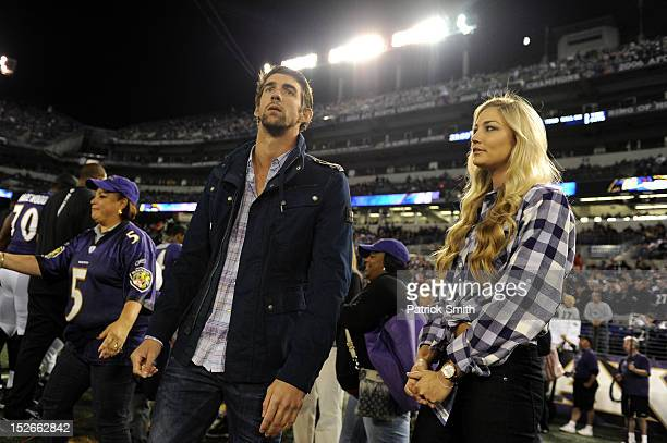 United States Olympic Swimmng Gold medalist Michael Phelps and his girlfriend Megan Rossee attend the NFL game between the Baltimore Ravens and the...