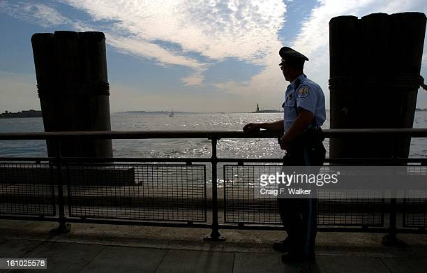 United States Park Police Officer L J D'Andrea looks towards the Statue of Liberty on the Hudson River from Battery Park in New York City Security...