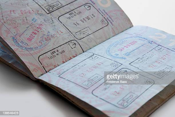 a united states passport with various country stamps - passeport photos et images de collection