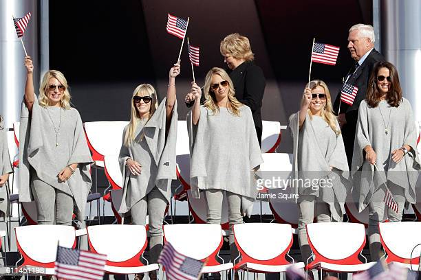 United States player partners Mandy Snedeker Justine Reed Nichole Moore Amy Mickelson Sybi Kuchar stand on stage during the 2016 Ryder Cup Opening...