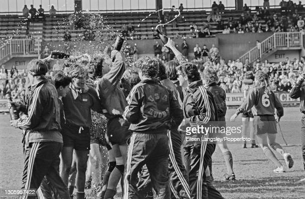 United States players and officials celebrate with bottles of Freixenet sparkling wine after beating England 19-9 in the final of the 1991 Women's...