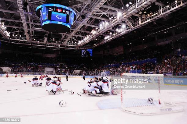 United States players celebrate after winning gold in the ice sledge hockey gold medal game between the Russian Federation and the United States of...