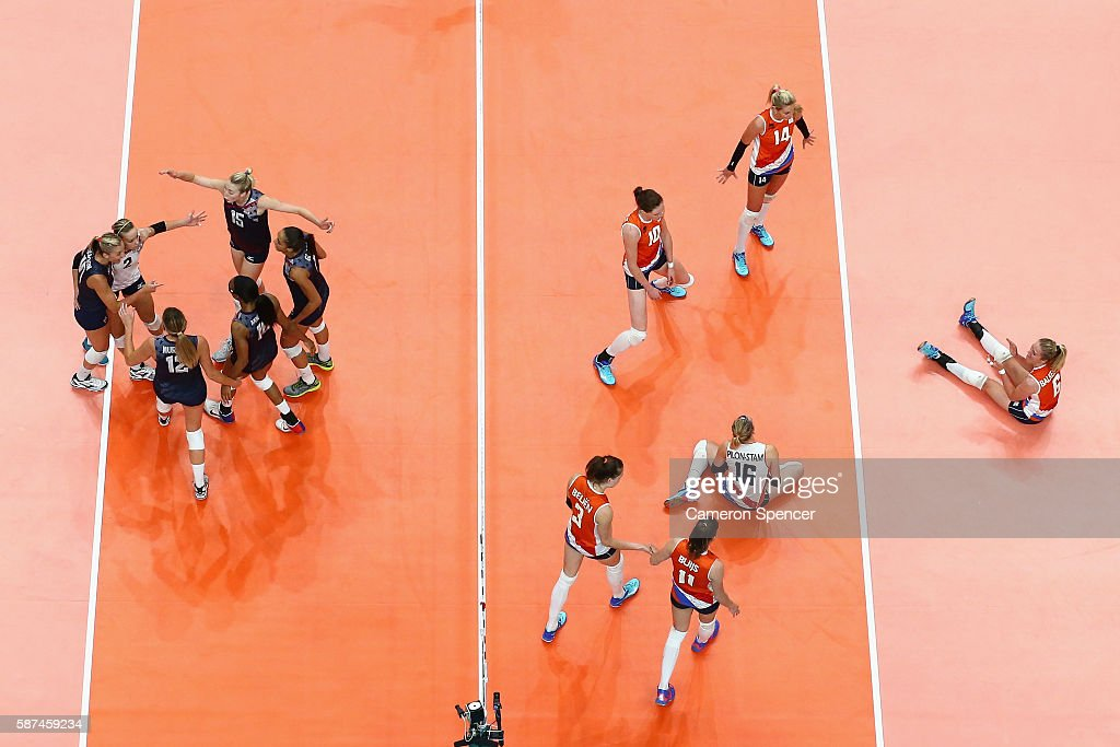 United States players celebrats a point during the Women's Preliminary Pool B match between the Netherlands and the United States on Day 3 of the Rio 2016 Olympic Games at the Maracanazinho on August 8, 2016 in Rio de Janeiro, Brazil.