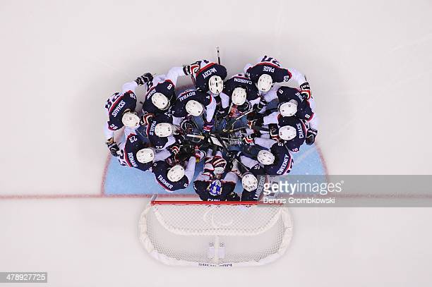 United States players huddle prior to the ice sledge hockey gold medal game between the Russian Federation and the United States of America at the...