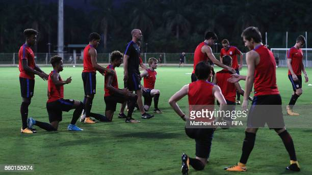 United States players warm up during a training session ahead of the FIFA U17 World Cup India 2017 tournament at DY Patil Stadium on October 11 2017...