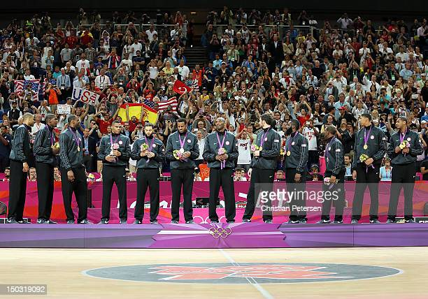United States poses with their gold medals following the Men's Basketball gold medal game against Spain on Day 16 of the London 2012 Olympics Games...