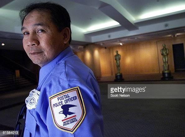 united states postal police officer adolfo flores stands