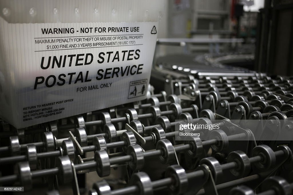 A United States Postal Service (USPS) mail tray is seen on a conveyor belt inside a USPS sorting center in Louisville, Kentucky, U.S., on Friday, Jan. 13, 2017. Starting January 22, the cost of mailing a one-ounce first-class letter will return to being 49 cents, up from 47 cents, where it had been since April. Photographer: Luke Sharrett/Bloomberg via Getty Images