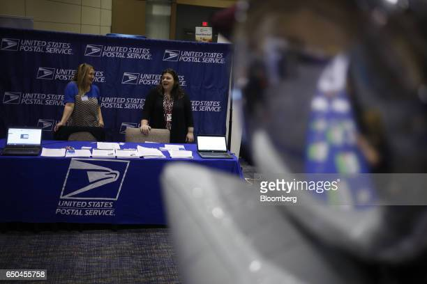 United States Postal Service recruiters wait to speak with job seekers during a Job News USA career fair in Overland Park Kansas US on Wednesday...