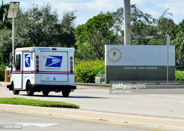 United States Postal Service truck drives past the entrance to FBI Miramar Headquarters where suspect Cesar Sayoc and his van are being housed on...