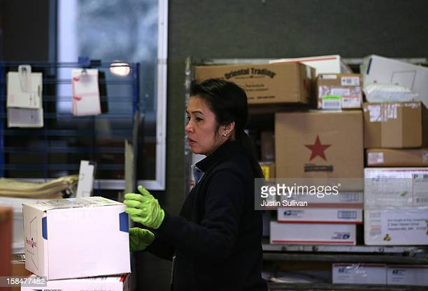 United States Postal worker arranges packages at the United States Post Office at Rincon Center on December 17 2012 in San Francisco California...