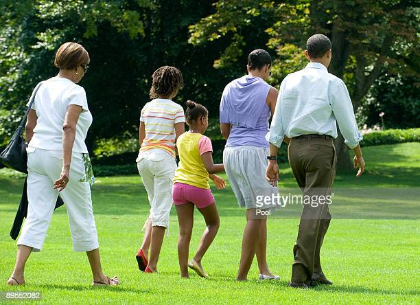 United States President Barack Obama and his family motherinlaw Marian Robinson daughters Malia and Sasha and first lady Michelle walk to Marine One...
