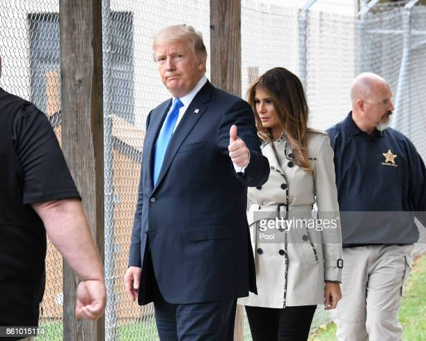 United States President Donald J. Trump acknowledges the press pool as he and first lady Melania Trump tour the U.S. Secret Service James J. Rowley...