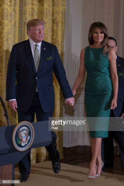United States President Donald J Trump and first lady Melania Trump enter the East Room of the White House prior to the Shamrock Bowl Presentation at...