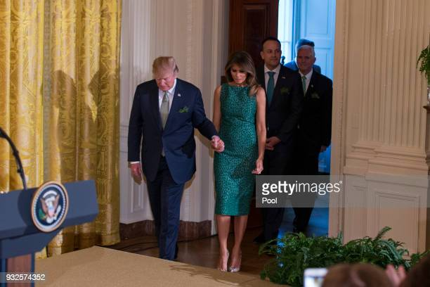 United States President Donald J Trump and first lady Melania Trump enter the East Room of the White House followed Prime Minister Leo Varadkar of...