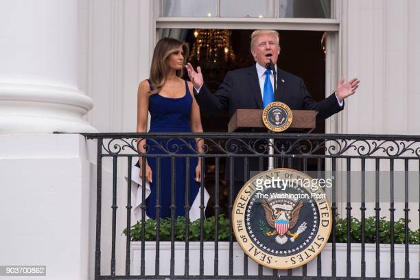 United States President Donald J Trump flanked by first lady Melania Trump speaks to guests during the military families picnic on the South Lawn of...