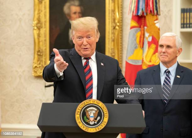 United States President Donald J Trump makes remarks as he hosts a naturalization ceremony in the Oval Office of the White House in Washington DC on...