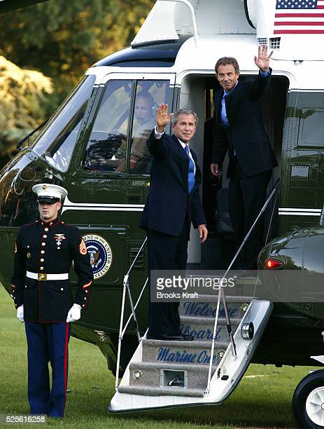 United States President George W Bush and British Prime Minister Tony Blair get onto Marine One as they depart the White House en route to Andrews...