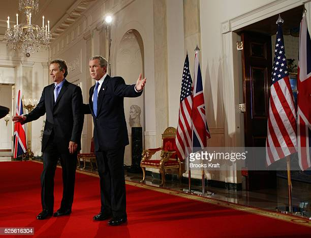 United States President George W Bush and British Prime Minister Tony Blair depart after conducting a joint press conference in the White House The...