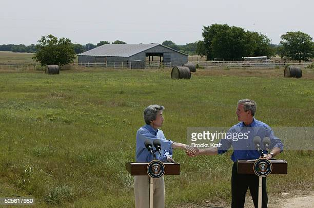 United States President George W Bush and Prime Minister Junichiro Koizumi of Japan shake hands at a joint press conference at the Bush Ranch...