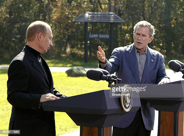 United States President George W Bush and Russian President Vladimir Putin conduct a press conference at Camp David, following two days of talks....