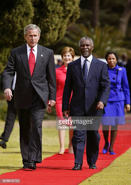 United States President George W. Bush and South African President Thabo Mbeki arrive, with US First Lady Laura Bush and South African First Lady...