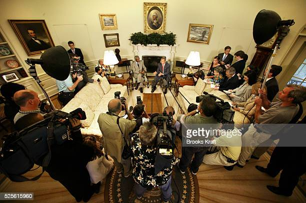 United States President George W Bush and United Nations Secretary General Kofi Annan speak to reporters after a meeting held to discuss...