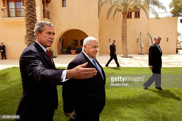 United States President George W Bush appears with Israeli Prime Minister Ariel Sharon before their trilateral meeting in Jordan