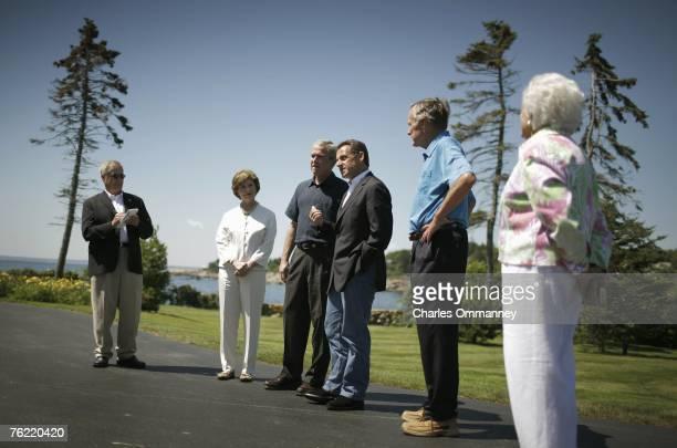 United States president George W Bush greets French President Nicolas Sarkozy as First Lady Laura Bush and former president George H W Bush and...