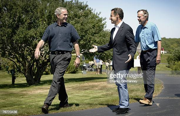 United States president George W Bush greets French President Nicolas Sarkozy with former president George H W Bushon 11 August 2007 at the Bush...