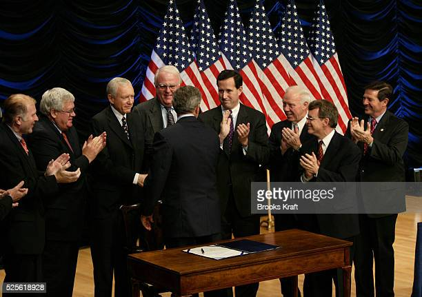 United States President George W Bush is applauded after signing legislation banning socalled 'partial birth' abortions in Washington DC The law will...