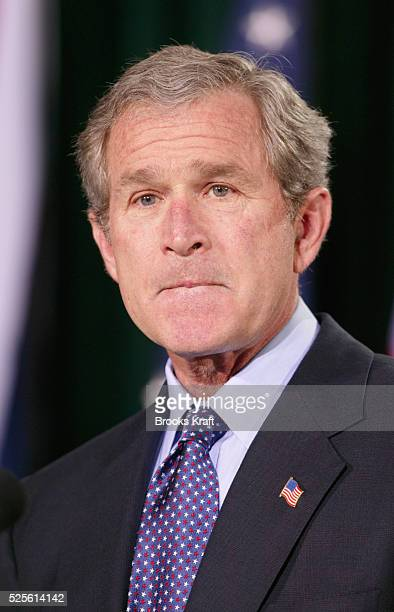 United States President George W Bush pauses during a joint news conference at Camp David in Maryland with British Prime Minister Tony Blair Faced...