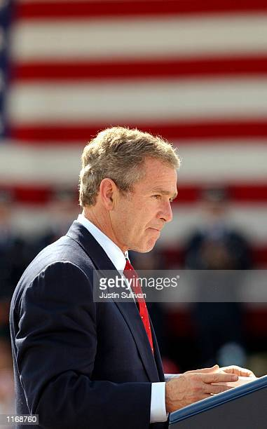 United States President George W. Bush pauses during a speech October 17, 2001 at Travis Air Force base in Fairfield, California. President Bush is...