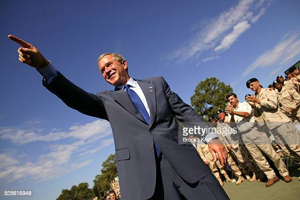 United States President George W. Bush points towards the crowd of soldiers during a visit with United States military personnel and family members...