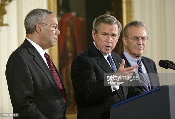 United States President George W. Bush speaks before signing an $87.5 billion package approved by Congress for Iraq and Afghanistan, during a...