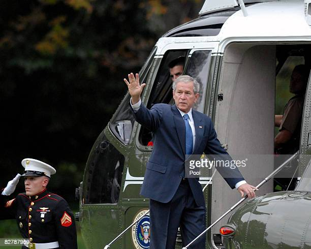 United States President George W Bush waves as he boards Marine 1 on the South Lawn of the White House for events in Oklahoma City September 12 2008...