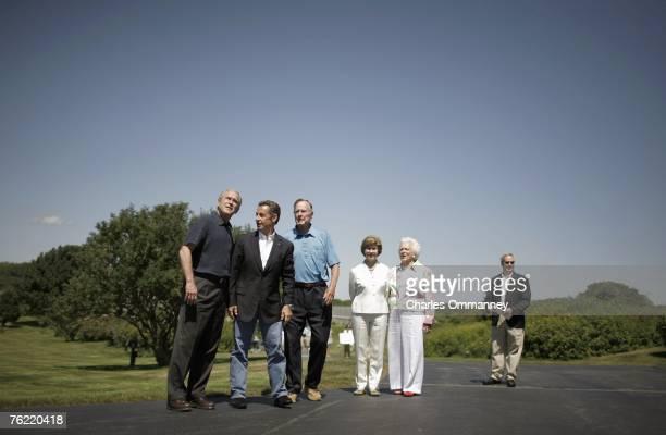 United States President George WBush greets French President Nicolas Sarkozy as his wife Barbara and former US president George HW Bush and First...