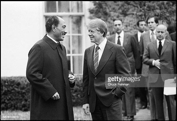 United States President Jimmy Carter, right, converses with Egyptian President Anwar Sadat outside the Oval Office at the White House, Washington,...