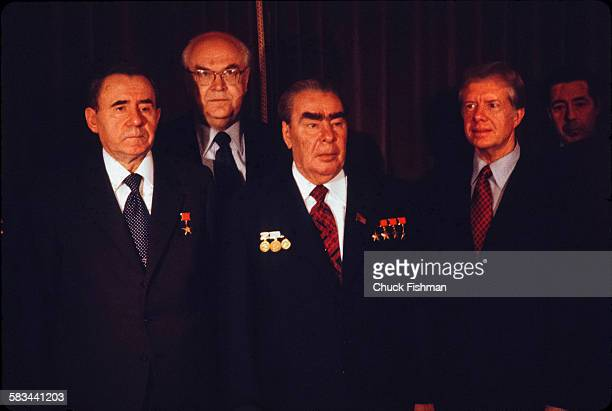 United States President Jimmy Carter right stands with Soviet Party members left to right Andrei Gromyko Anatoly Dobrynin and Secretary General...