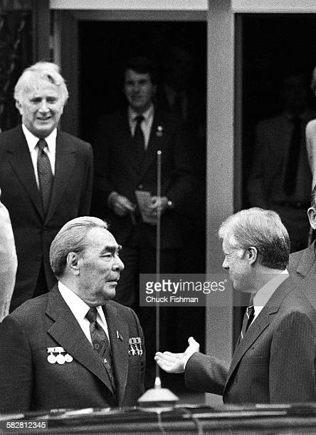 United States President Jimmy Carter right welcomes Soviet Communist Party Secretary General Leonid Brezhnev to the American embassy in Vienna for...