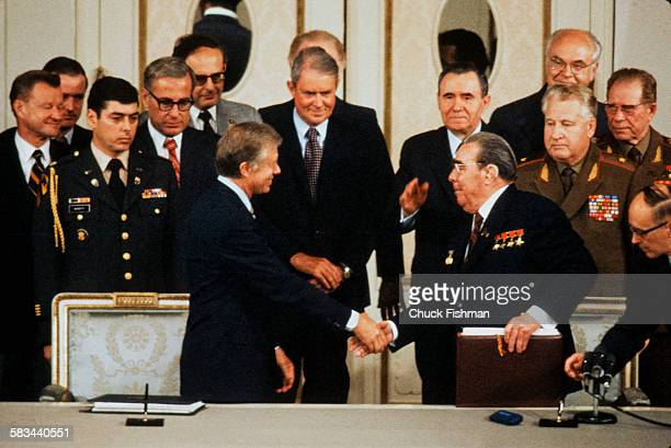 United States President Jimmy Carter shakes hands with Russian Communist Party General Secretary Leonid Brezhnev after signing SALT II Vienna Austria...