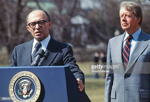 United States President Jimmy Carter stands behind Israeli Prime Minister Menachem Begin, while Begin addresses the press after a round of...