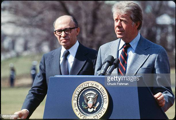 United States President Jimmy Carter stands on the podium with Israeli Prime Minister Menachem Begin behind him, while addressing the press after a...