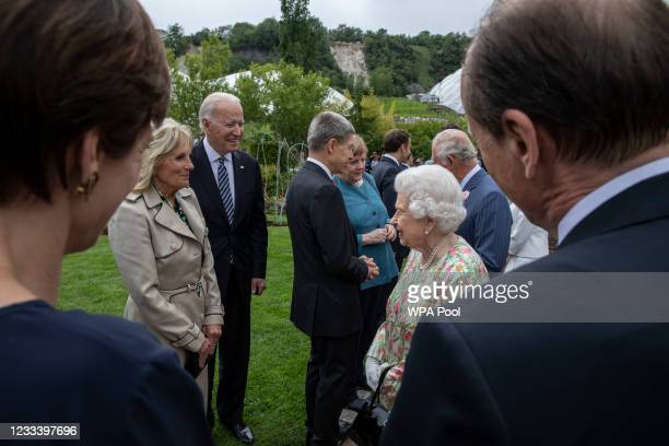 United States President Joe Biden, First Lady Jill Biden and Queen Elizabeth II chat at a drinks reception for Queen Elizabeth II and G7 leaders at...